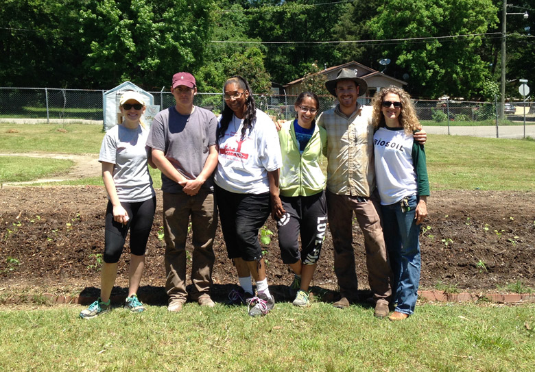 SumaGrow staff at Community Garden